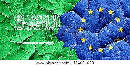 Saudi Arabia flag with european union flag on a grunge cracked w