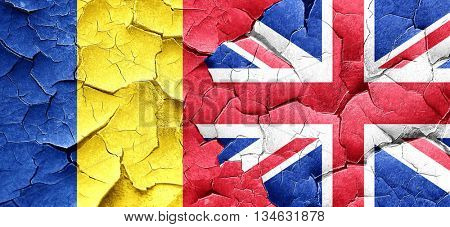 Romania flag with Great Britain flag on a grunge cracked wall