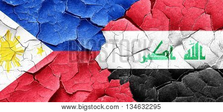 Philippines flag with Iraq flag on a grunge cracked wall