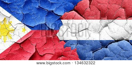 Philippines flag with Netherlands flag on a grunge cracked wall