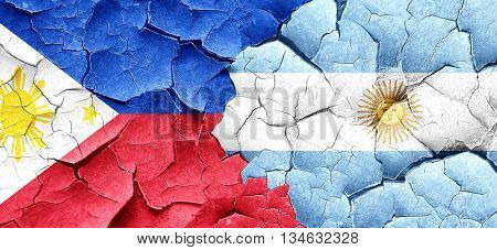 Philippines flag with Argentine flag on a grunge cracked wall