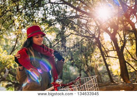 Girl Riding Bike At Park On Sunny Fall Season