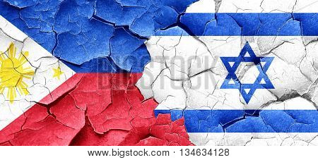 Philippines flag with Israel flag on a grunge cracked wall