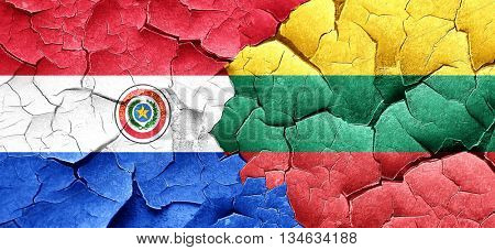 Paraguay flag with Lithuania flag on a grunge cracked wall