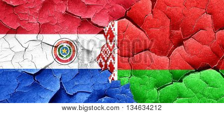 Paraguay flag with Belarus flag on a grunge cracked wall