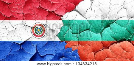 Paraguay flag with Bulgaria flag on a grunge cracked wall