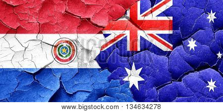 Paraguay flag with Australia flag on a grunge cracked wall