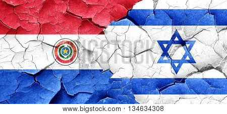 Paraguay flag with Israel flag on a grunge cracked wall