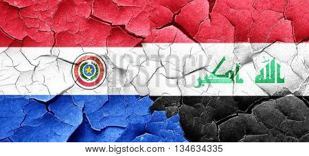 Paraguay flag with Iraq flag on a grunge cracked wall