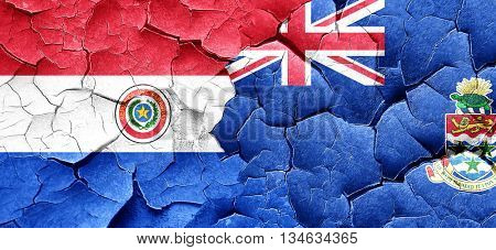 Paraguay flag with Cayman islands flag on a grunge cracked wall