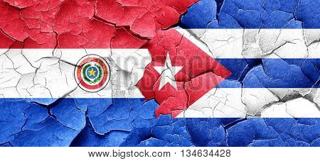 Paraguay flag with cuba flag on a grunge cracked wall