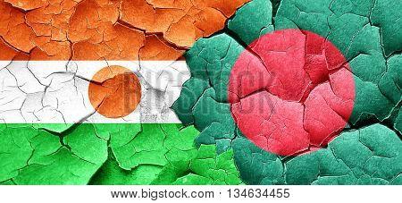 niger flag with Bangladesh flag on a grunge cracked wall