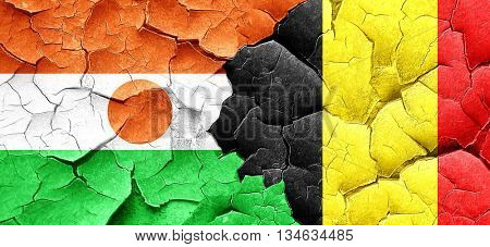 niger flag with Belgium flag on a grunge cracked wall