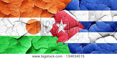 niger flag with cuba flag on a grunge cracked wall