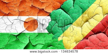 niger flag with congo flag on a grunge cracked wall