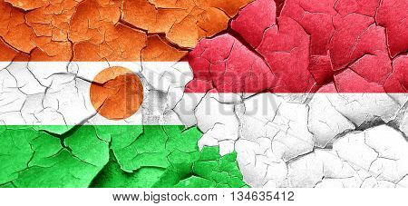 niger flag with Indonesia flag on a grunge cracked wall