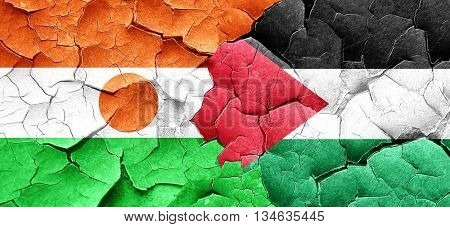 niger flag with Palestine flag on a grunge cracked wall