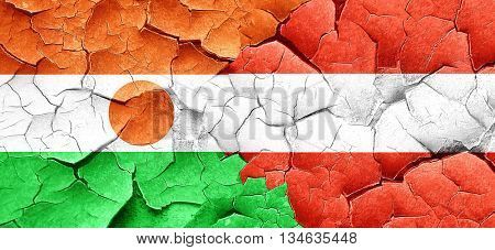 niger flag with Austria flag on a grunge cracked wall