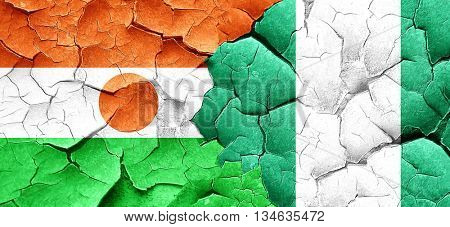 niger flag with Nigeria flag on a grunge cracked wall