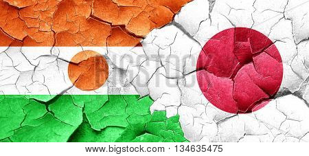 niger flag with Japan flag on a grunge cracked wall
