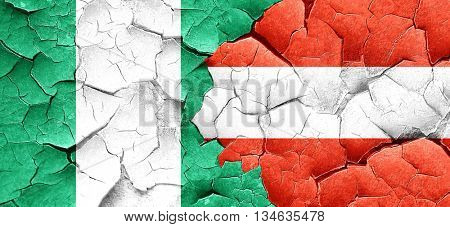Nigeria flag with Austria flag on a grunge cracked wall