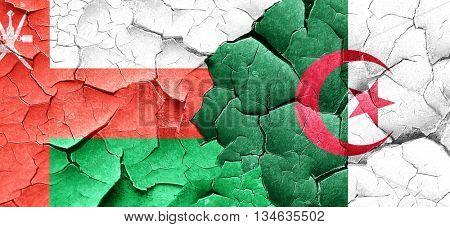 Oman flag with Algeria flag on a grunge cracked wall