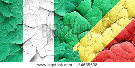 Nigeria flag with congo flag on a grunge cracked wall