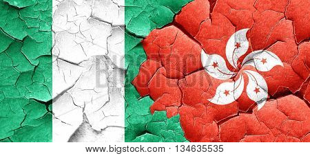 Nigeria flag with Hong Kong flag on a grunge cracked wall