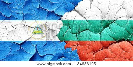 nicaragua flag with Bulgaria flag on a grunge cracked wall