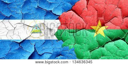 nicaragua flag with Burkina Faso flag on a grunge cracked wall