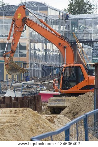 excavator works at the construction site in the city