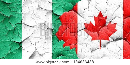 Nigeria flag with Canada flag on a grunge cracked wall