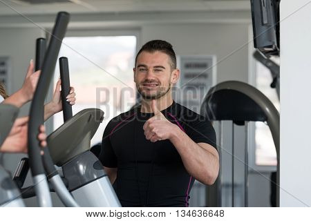 Personal Trainer Showing Ok Sign To Client