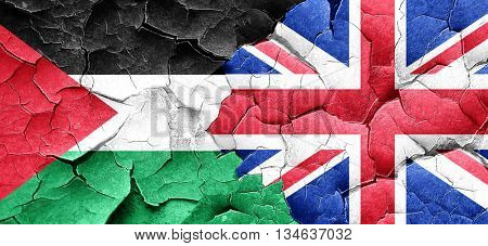 palestine flag with Great Britain flag on a grunge cracked wall