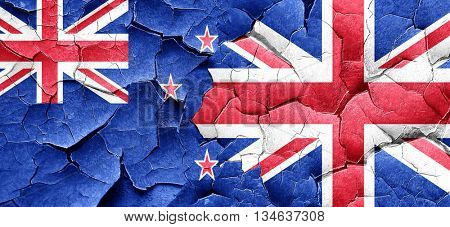 New zealand flag with Great Britain flag on a grunge cracked wal