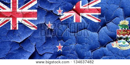 New zealand flag with Cayman islands flag on a grunge cracked wa