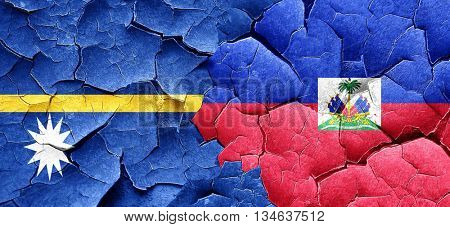 Nauru flag with Haiti flag on a grunge cracked wall