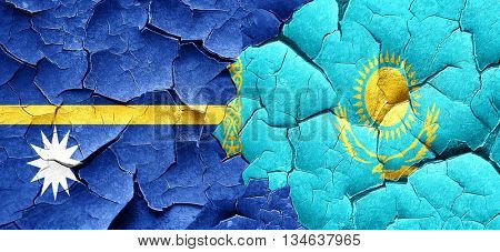 Nauru flag with Kazakhstan flag on a grunge cracked wall