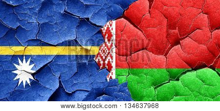 Nauru flag with Belarus flag on a grunge cracked wall