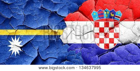 Nauru flag with Croatia flag on a grunge cracked wall