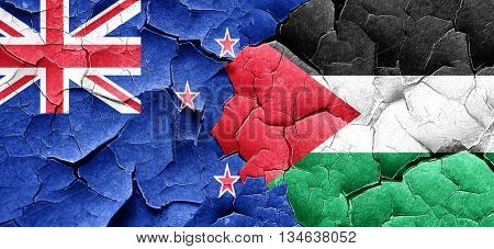 New zealand flag with Palestine flag on a grunge cracked wall