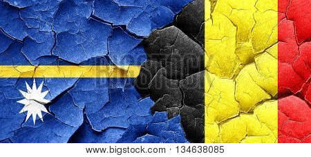 Nauru flag with Belgium flag on a grunge cracked wall