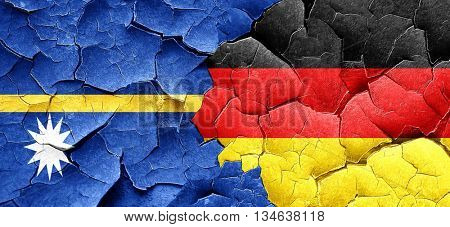 Nauru flag with Germany flag on a grunge cracked wall