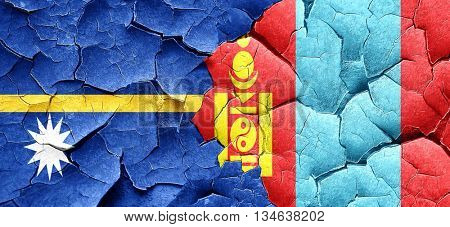 Nauru flag with Mongolia flag on a grunge cracked wall
