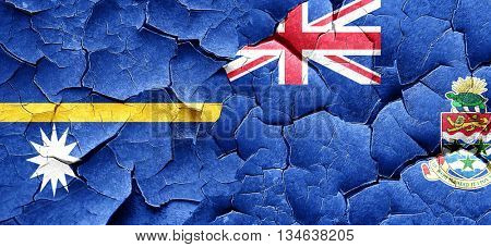 Nauru flag with Cayman islands flag on a grunge cracked wall