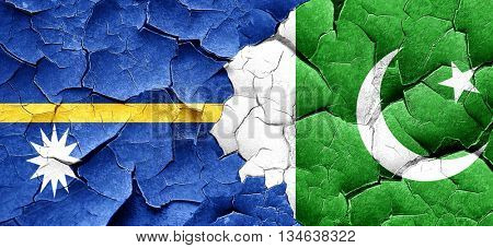 Nauru flag with Pakistan flag on a grunge cracked wall
