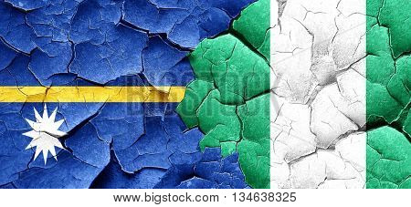 Nauru flag with Nigeria flag on a grunge cracked wall