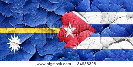 Nauru flag with cuba flag on a grunge cracked wall