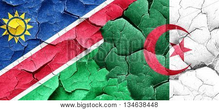 Namibia flag with Algeria flag on a grunge cracked wall