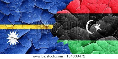 Nauru flag with Libya flag on a grunge cracked wall